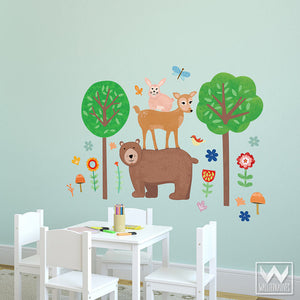 Decorate a child's playroom with removable wall decals and woodland animals