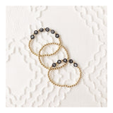 The Letter Bracelet: Gold with Black Letter Beads
