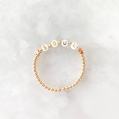 The Star Letter Bracelet: Gold with White and Gold Letter Beads