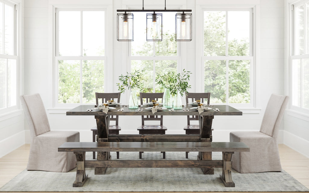 "7' L x 37"" W Trestle Table with Jointed top style, Trestle Bench for 7' table both with top knots filled, William Dining Chairs all in Deep Grey Finish and our Brady Slipcover Chair."