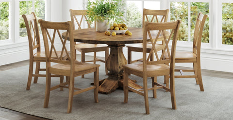 Round Heirloom pedestal table with filled table top knots and Double X-Back Chairs in Harvest Wheat finish.