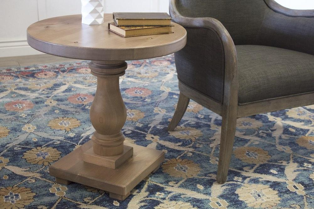 "24"" Vivien Turned Pedestal Round End Table in Barn Wood Finish."