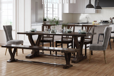 "7' L x 37"" W Vera Trestle Dining Table, Vera Dining Bench both with filled knots and Brooklyn Dining Chairs all in Tobacco finish. Also pictured our Morgan Linen Dining Chair in Warm Grey."