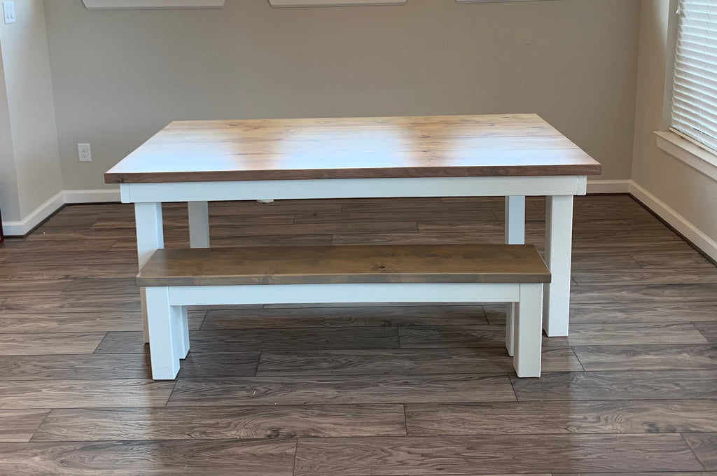 "6.5' L x 42"" W Farmhouse Table - Hardwood, Boarded Look - Grooved Top in Harvest Wheat Finish with Ivory Painted Base with Top Knots Filled. Also pictured our Farmhouse Bench for 6.5' L Table in Harvest Wheat Finish with a painted Ivory Base."