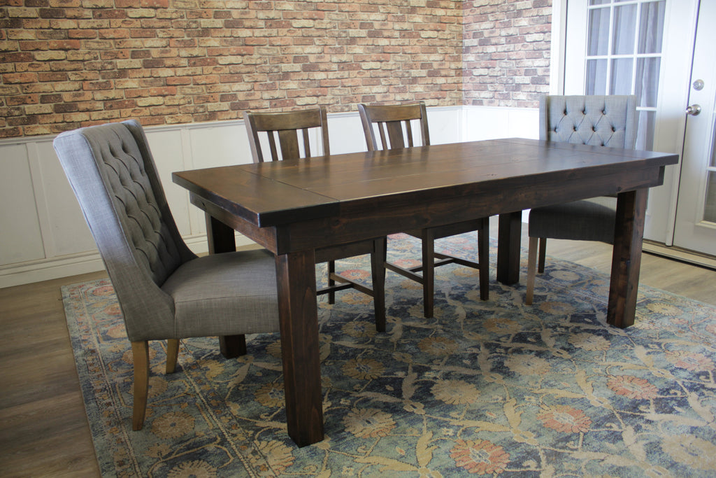 Farmhouse Table - Hardwood, in Tobacco Finish with Boarded Look / Grooved top with Endcaps and Tobacco Finish base. Also pictured William Dining Chair in Tobacco Finish and the Lauren Tufted Linen Chair in Oxford Warm Grey