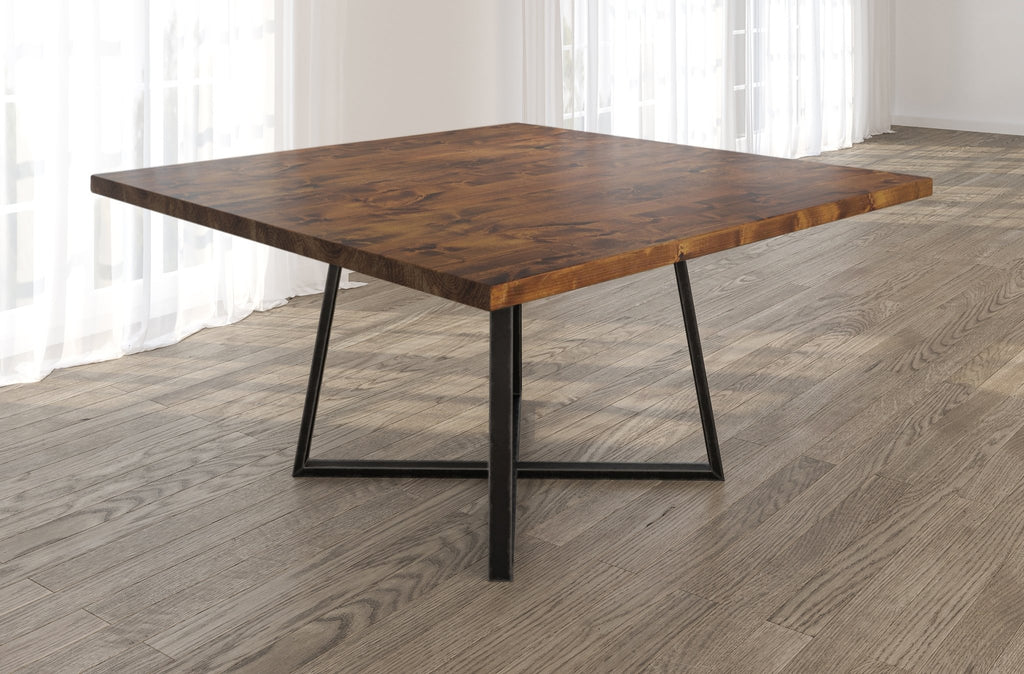 Square Watson Industrial Steel Pedestal Table with Filled Knots in Tuscany finish.