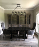 Bentwood Upholstered Armchairs paired with an Expandable Vera Trestle Table in Charred Ember finish with Jane Hardwood Dining Chairs.