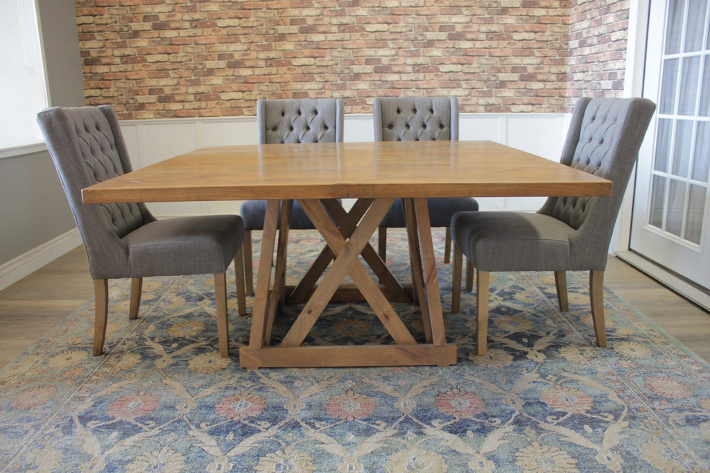"60"" Julia Square Dining Table with Natural Open Knots in Harvest Wheat Finish. Also pictured our Lauren Tufted Linen Chair in Oxford Warm Grey."