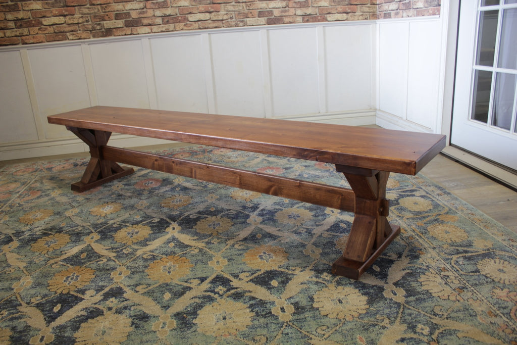 7' Trestle Bench in Tuscany Finish with natural open knots.