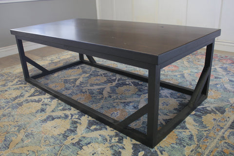 "60"" L X 30"" W X 18"" T Emmalyn Coffee Table in Charred Ember Finish with Natural Open Knots"