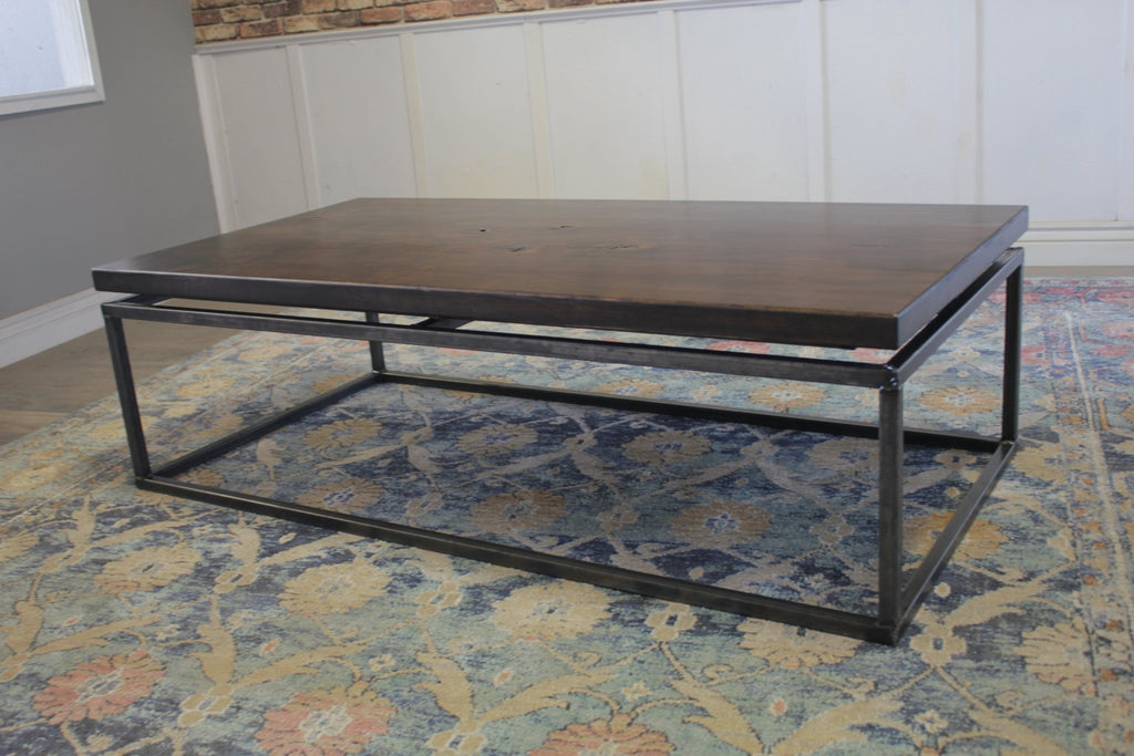 "60"" L X 30"" W X 18"" T Floating Top  Coffee Table in Tobacco Finish with Natural Open Knots"