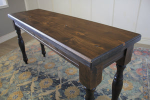 "5' L X 18"" D X 30"" T Abigail Turned Leg Sofa Table in Tobacco Finish with natural open knots"