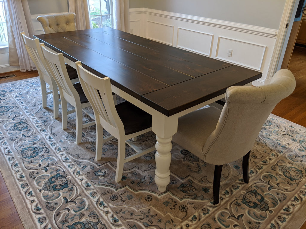 "Henry Dining Chairs painted Ivory and Tobacco Finish seats. Also pictured a 8' X 42"" X 30"" T Baluster Turned Leg Table, Boarded Look with Endcaps, Table Top Knots Filled, Tobacco Finish Top and Ivory Painted base."