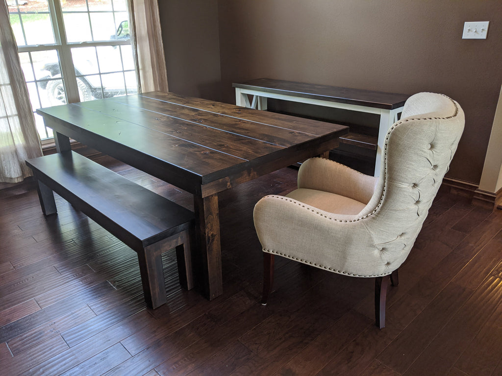 "The Farmhouse Table at approx. 7'L x 45""W x 30""T in the Tobacco Finish on the top and base, with a Boarded Look - Grooved top style and the knots left open and natural, with a coordinating Farmhouse Bench and Cynthia Tufted Armchair"
