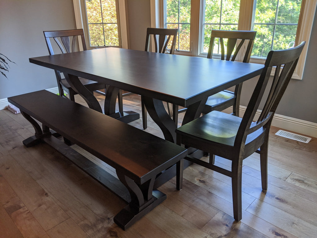 "The Vera Trestle Table at approx. 6'L x 37""W with a coordinating Vera Dining Bench and Brooklyn Dining Chairs in the Charred Ember Finish"