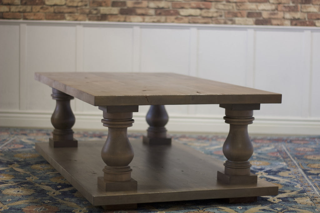 "5' L x 36"" W x 21"" H Vivien Turned Pedestal Coffee Table in Barn Wood Finish."