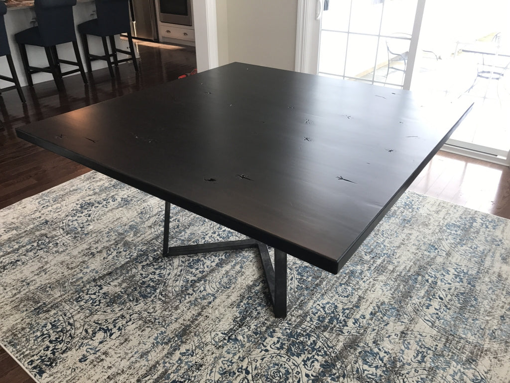"60"" x 60"" Square Watson Industrial Steel Pedestal Table in Charred Ember Finish."