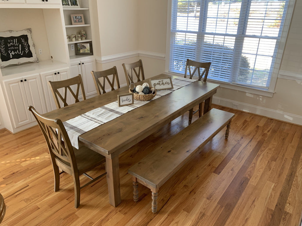 "8' L x 45"" W Farmhouse Table - Hardwood, Jointed Top in Harvest Wheat Finish with Knots on Top of Table Filled With Clear Epoxy. Also pictured our Double X Back Dining Chairs in Harvest Wheat Finish and the Annli Bench with Knots on Top of Bench Filled With Clear Epoxy in Harvest Wheat Finish"
