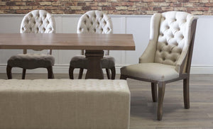 Sophie Round Tufted Linen Chairs paired with the Anna Deconstructed Wingback, the Hadley Bench, and an Heirloom Pedestal Table customized in Knotty Alder with our Barn Wood Finish