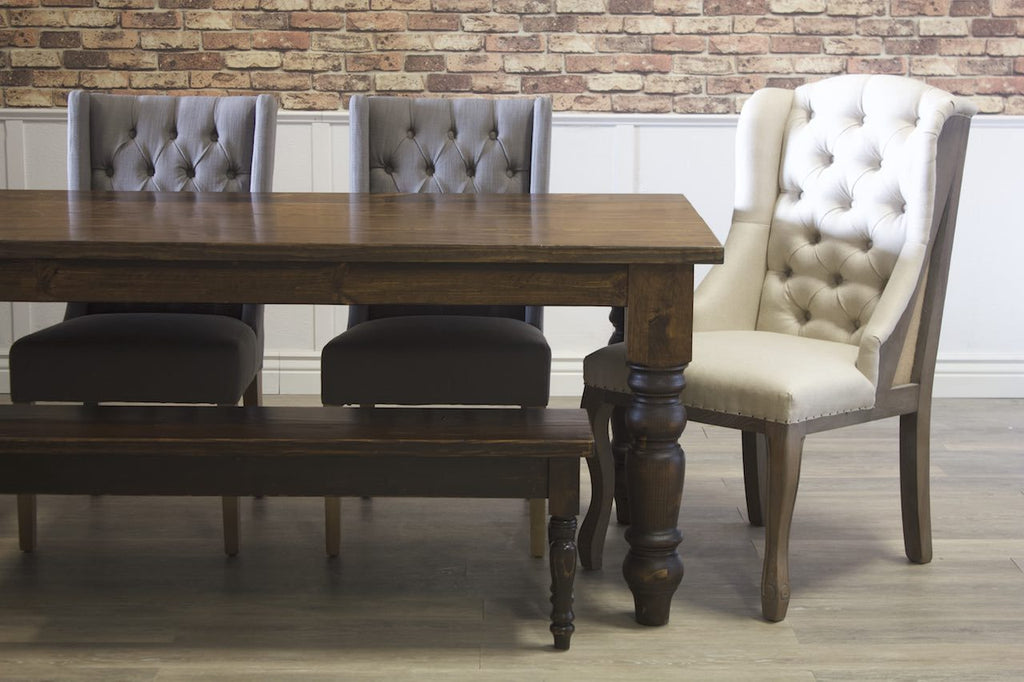 Warm Oxford Grey Lauren Tufted Linen Chairs pictured with an Anna Deconstructed Wingback Chair. Pictured with a Baluster Turned Leg Table and Dianne Bench both in Dark Walnut stain.