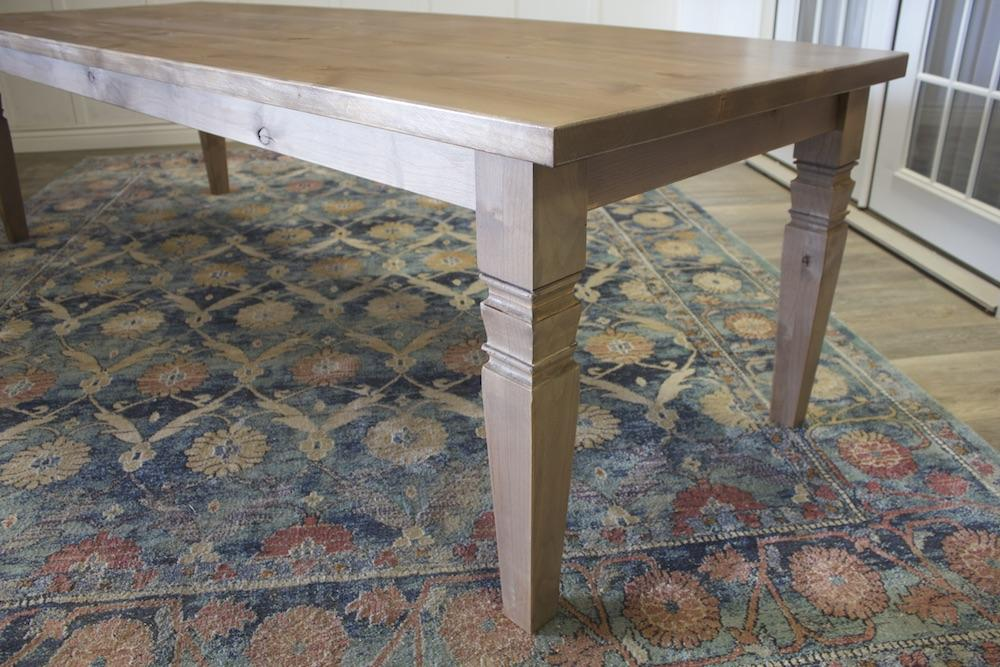 Charlotte Turned Leg Dining Table in Barn Wood Finish.