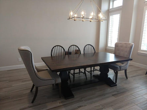 Natural Linen Elouise Dining Chairs paired with a 7' L - 9' L Expandable Heirloom Pedestal Table with a Dark Walnut stained top and Midnight stained base.
