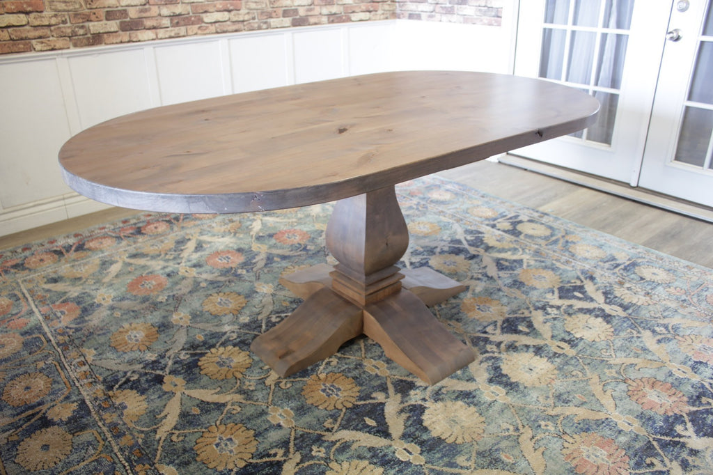 "6' L x 38"" W Oval Heirloom Pedestal Table with Top Knots Filled in Barn Wood Finish."