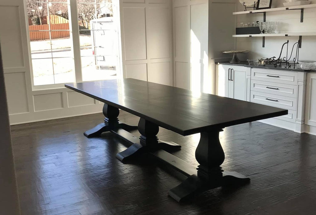 "11' L x 45"" W Heirloom Pedestal Dining Table  in Charred Ember finish."