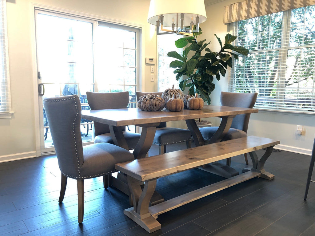 "Custom 76"" L Vera Dining Bench in Barn Wood Finish. Also pictured a Custom 76"" L x 35"" W x 30"" H in Barn Wood Finish with Top Knots Filled and our Morgan Linen Dining Chair."