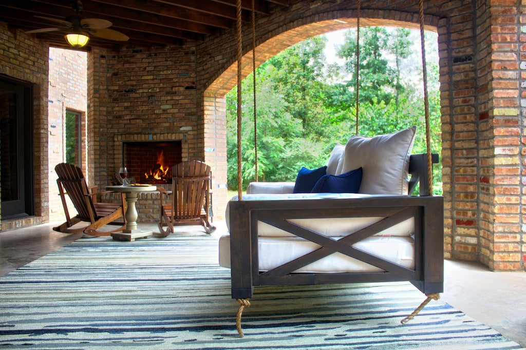 Finley Wood Porch Swing Bed Daybed, Twin Size, Charred Ember Finish. Outdoor Adirondack Rockers pictured in background.