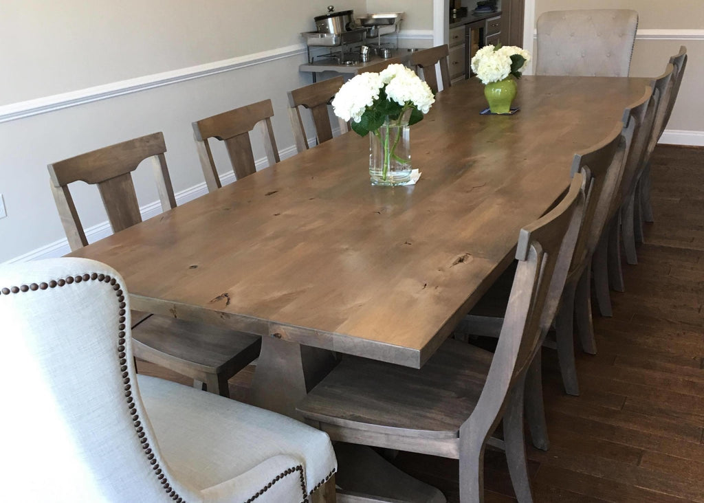 Grace Dining Chairs in Barn Wood Finish. Pictured with an Heirloom Pedestal Table customized in solid Knotty Alder.