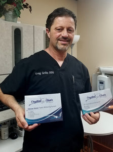 dentist recommending teeth whitening kit