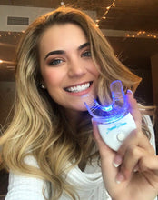 Load image into Gallery viewer, Wisconsin graduate using Crystal Clear teeth whitening kit