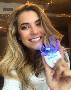 Wisconsin graduate using Crystal Clear teeth whitening kit