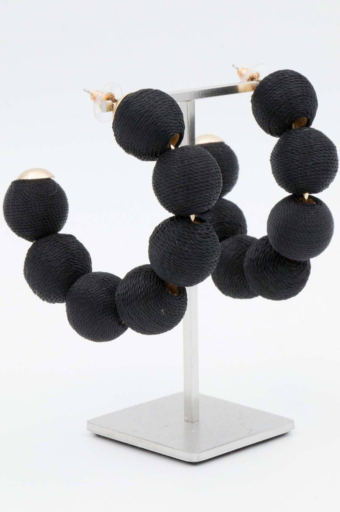 Black Pom Pom Curve Earrings - desray.co.za