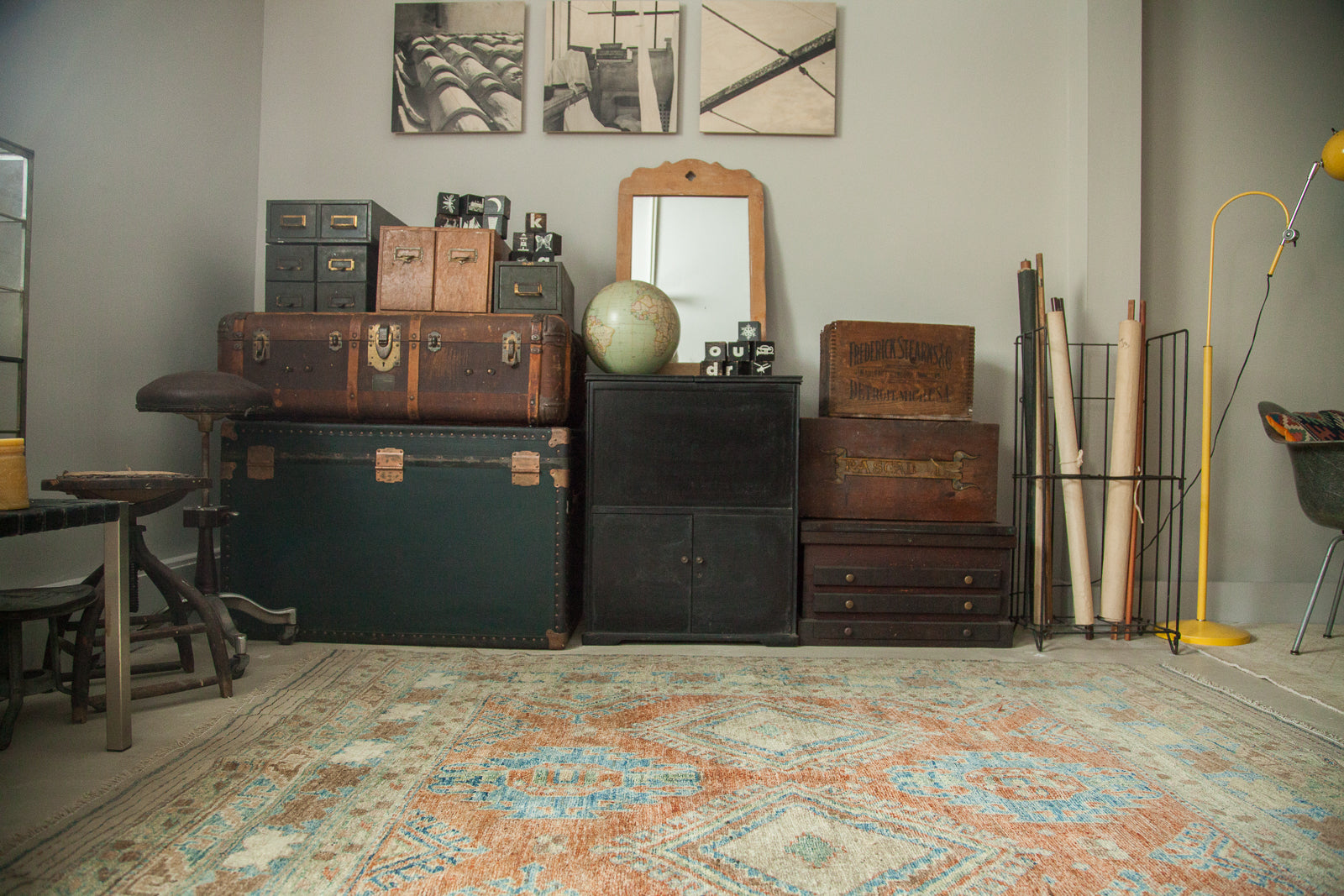 Vintage Luggage, mirrors, globes, and more along with vintage rugs and antique carpets are stored in our studio barn in New York