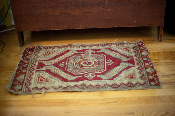 Small red throw rug