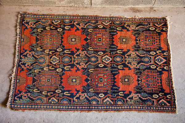 Black red and blue antique rug