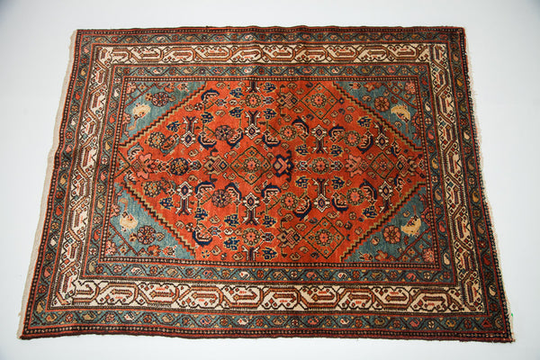 Small red Persian rug