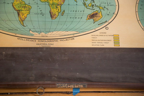 Vintage 1930s Cram's Pull Down Map hanging on wooden dowels of eastern and western hemispheres