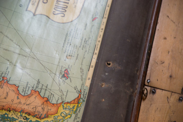 Wooden Dowels used to hang this large pull-down map of South America