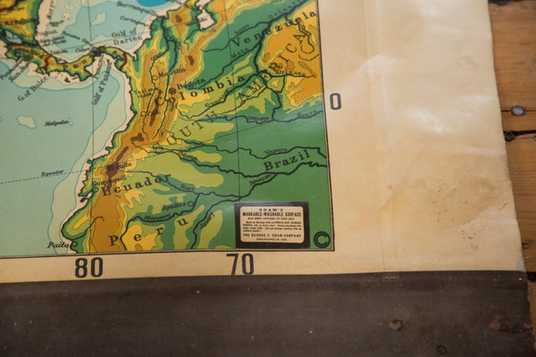 Vintage large pull down map of North America hanging on wooden dowels