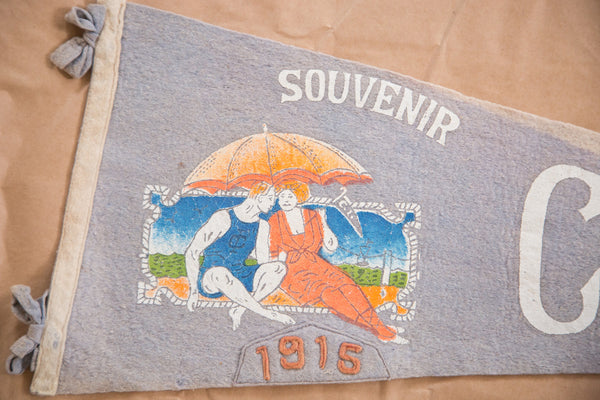 Graphic of beach goers on antique 1915 coney island NY felt flag pennant