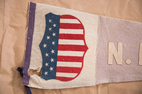 Hole present in this antique NE fair felt flag pennant