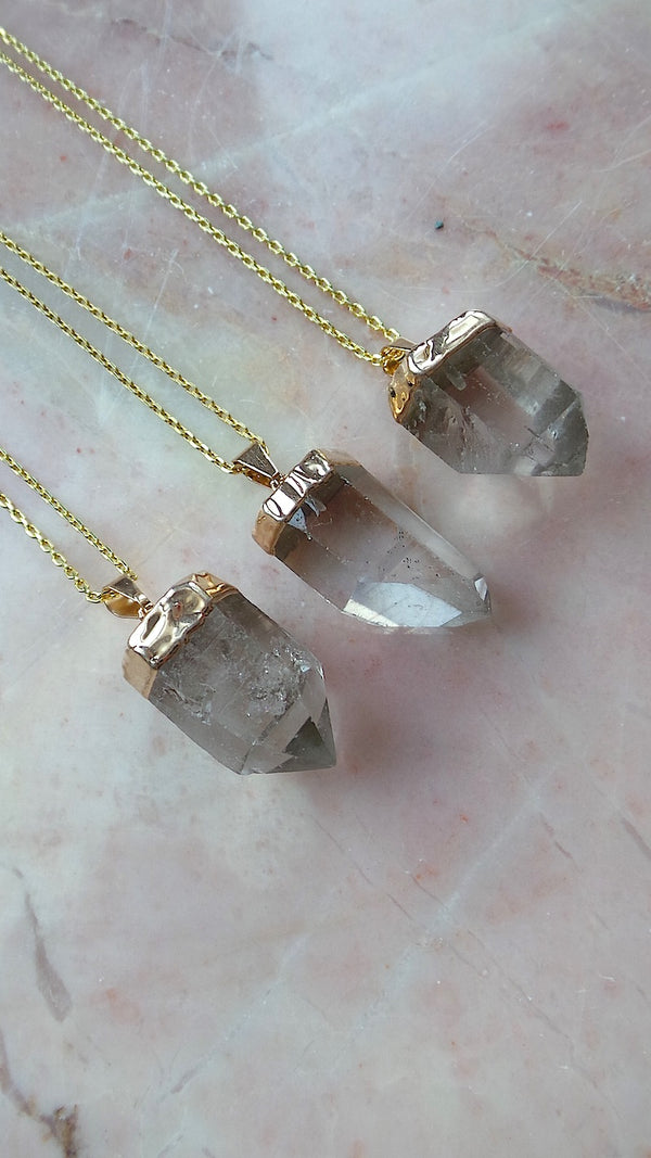 Clear Quartz point gold necklace