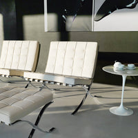 Knoll's Barcelona Chair and Ottoman, designed by Mies Van der Rohe shown in Volo Parchment White.