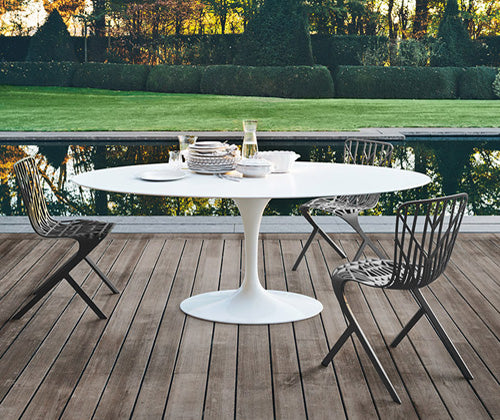 Knoll Outdoor Saarinen Oval Dining Table and Skeleton Chairs