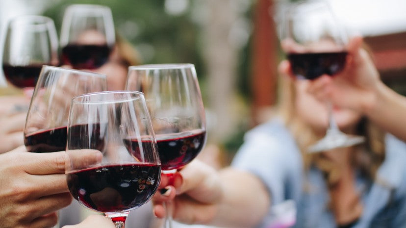 people drinking red wine with antioxidants