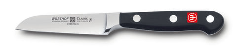4000-7 wusthof classis flat cut paring knife. three inch. riveted handle.