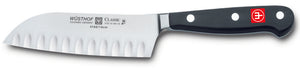 4182-7 wusthof classic hollow edge santoku. 5 inches. riveted handle.